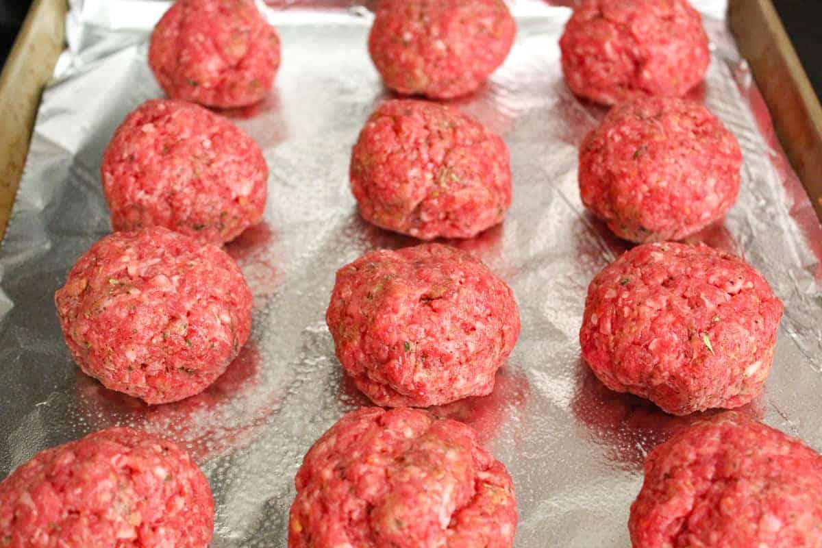 Meatballs on a foil lined baking sheet