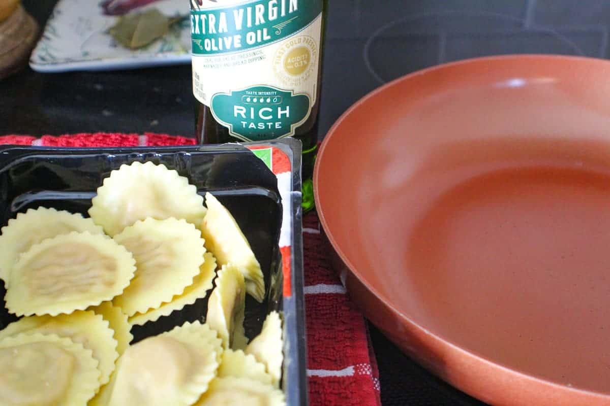 Ingredients for fried ravioli-pasta, oil and skillet