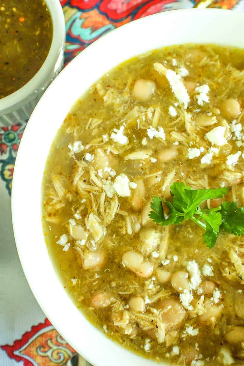 Close up vertical image of New Mexico Green Chile Chicken Soup with cilantro on top