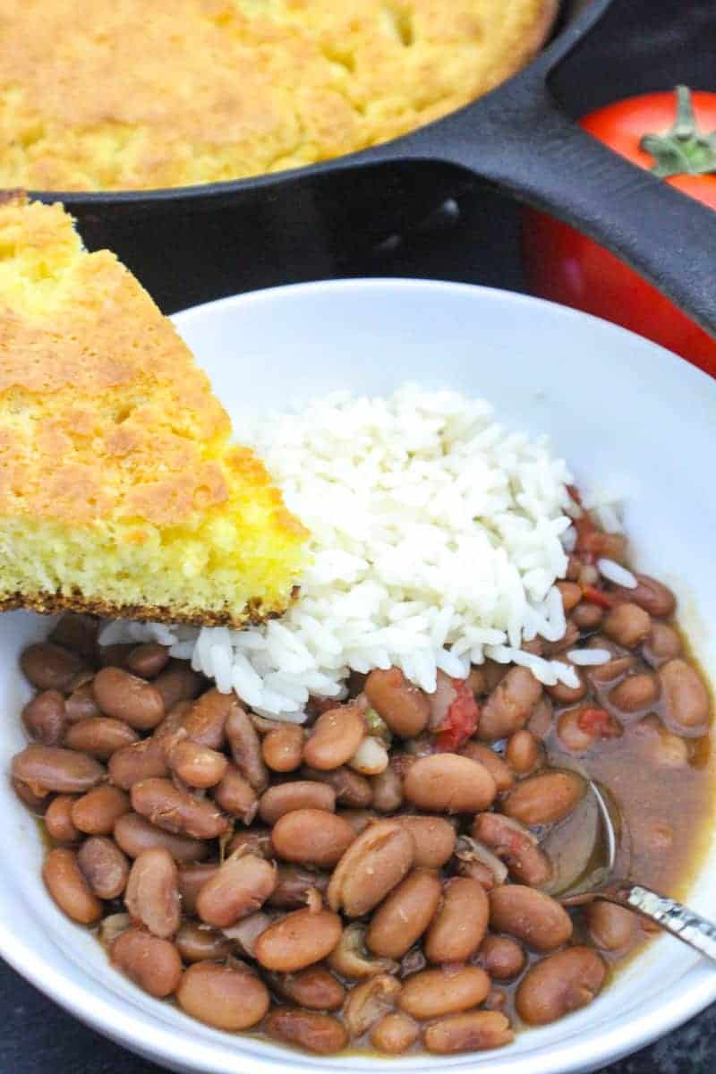 Bowl of Southern Rice and Beans with a slice of cornbread