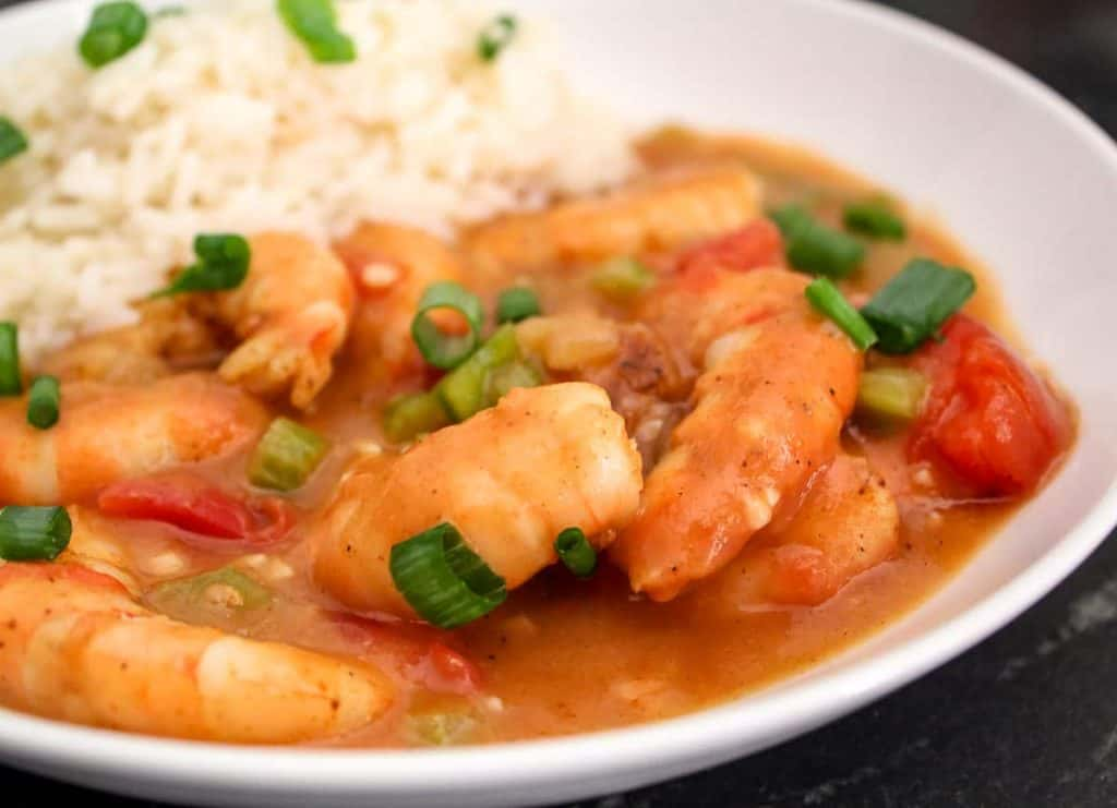 Close up of shrimp etouffee with a side of rice