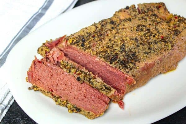 sliced corned beef on white plate