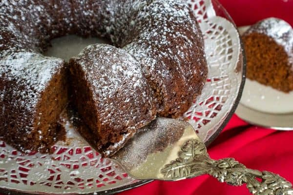 Sliced gingerbread bundt cake garnished with powdered sugar