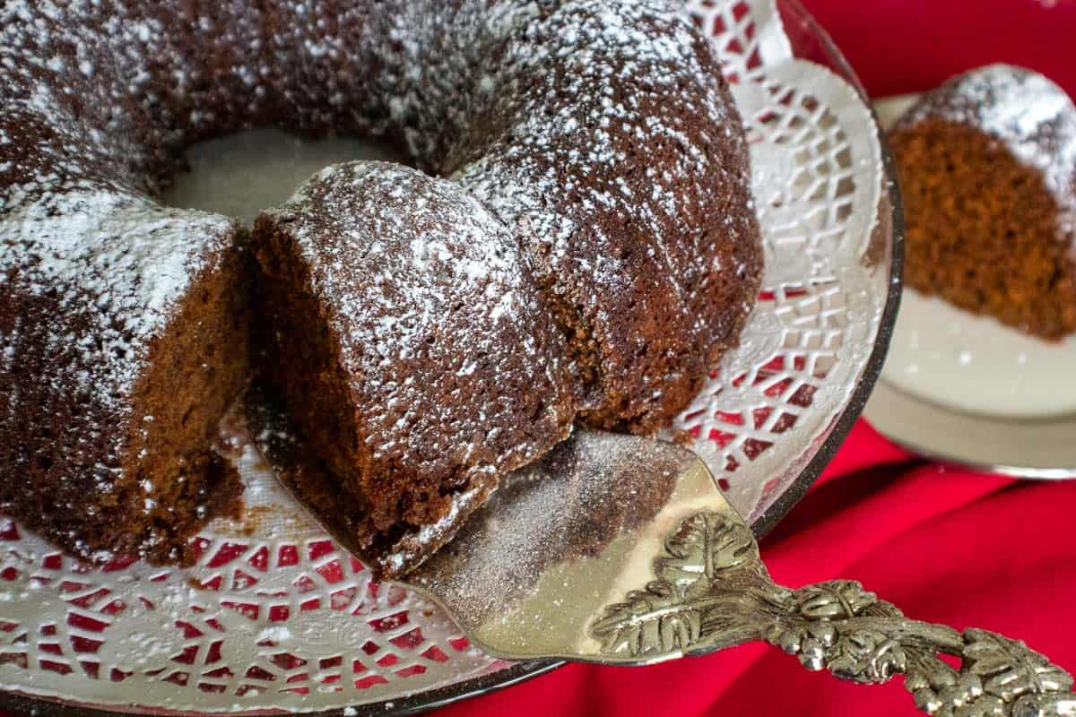Bundt cake sliced and sprinkled with powdered sugar