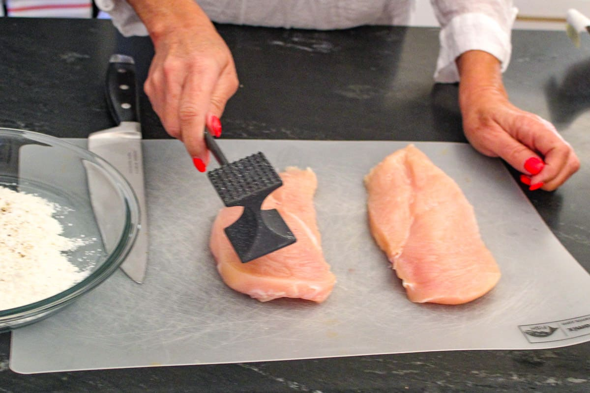 Meat cleaver pounding chicken breast