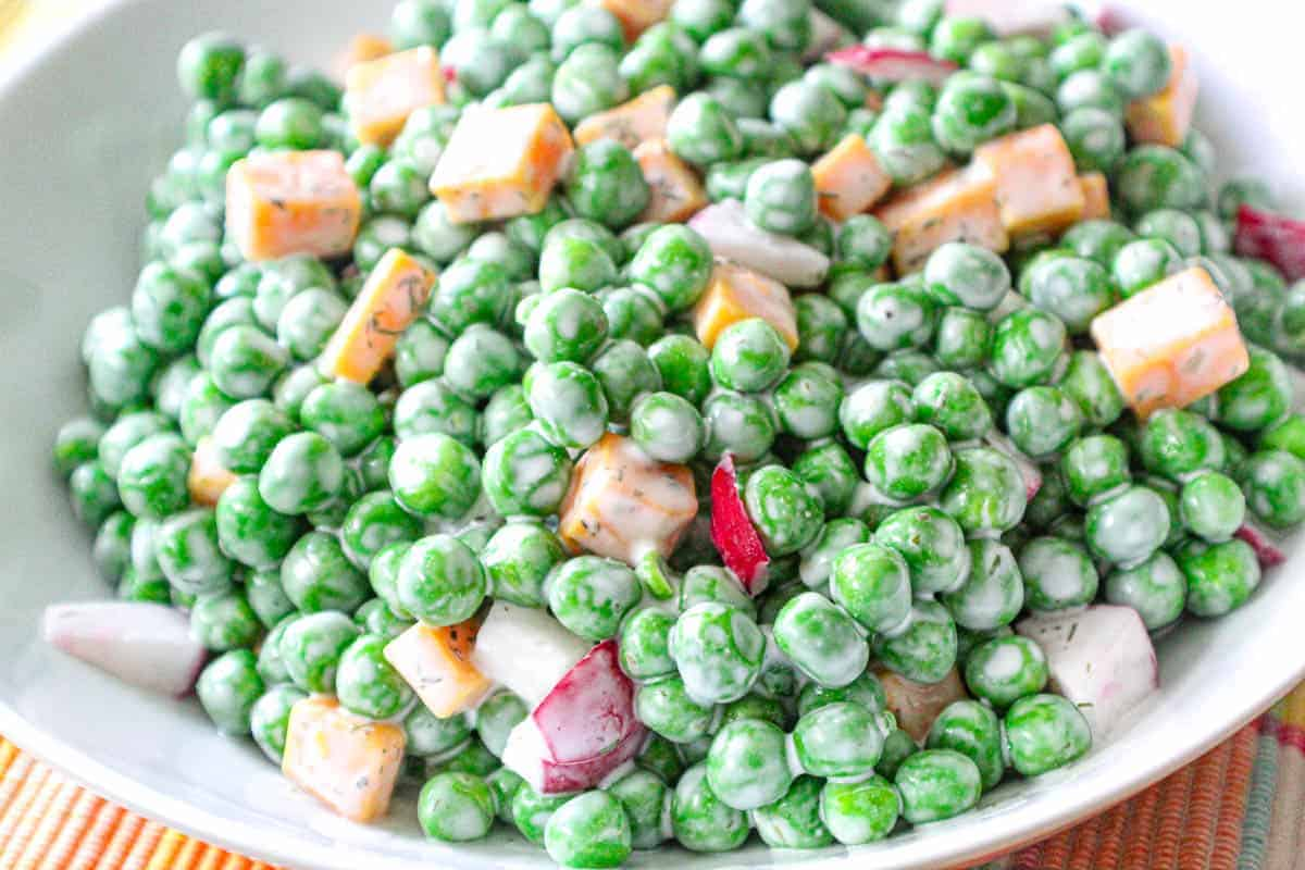 Close up of English Pea Salad in white bowl