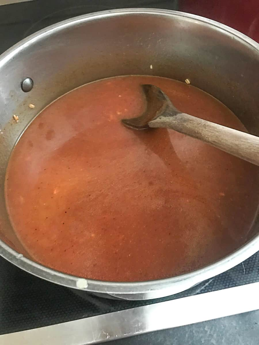 Tomato sauce added to stockpot