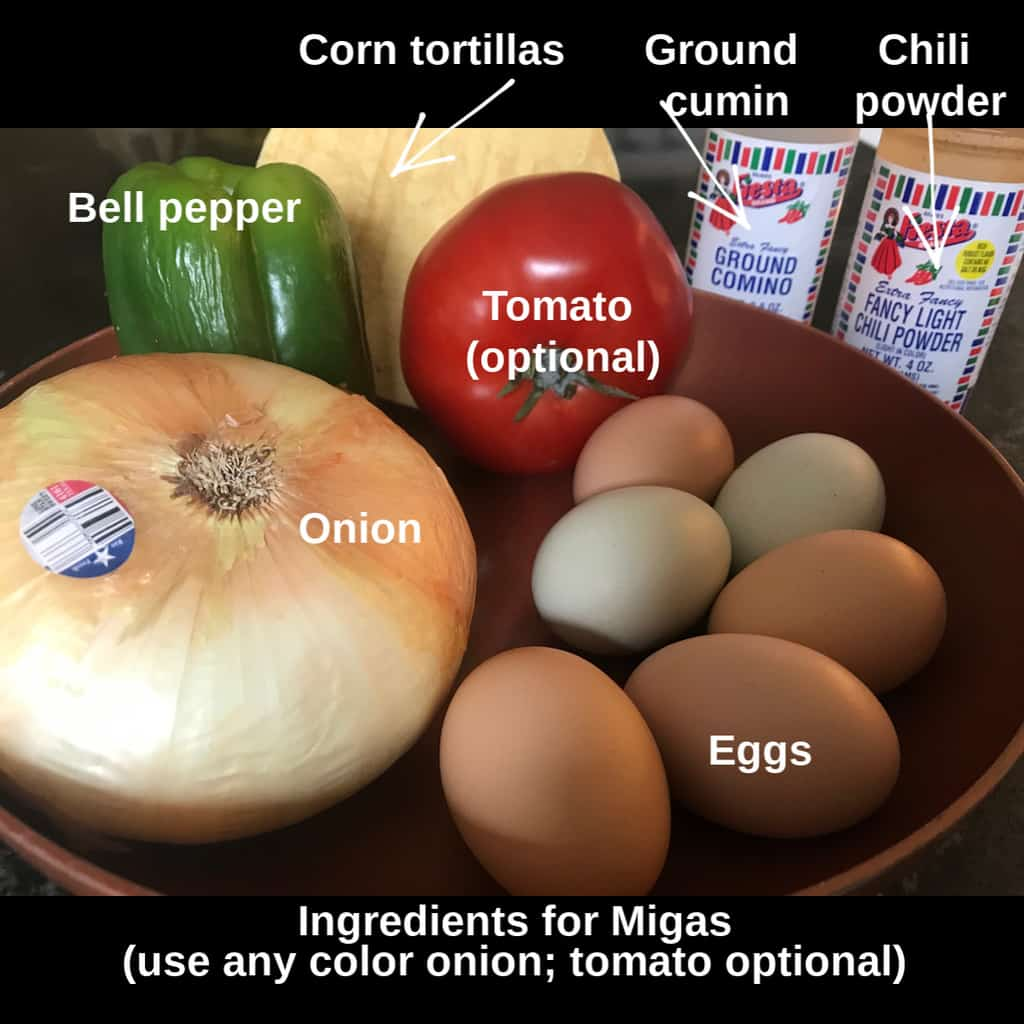 Ingredients for Tex Mex migas: onion, egg, bell pepper tortillas, seasonings