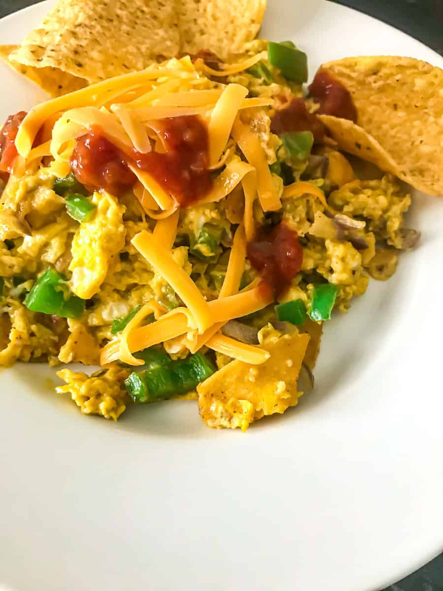Tex Mex Migas topped with cheese and salsa