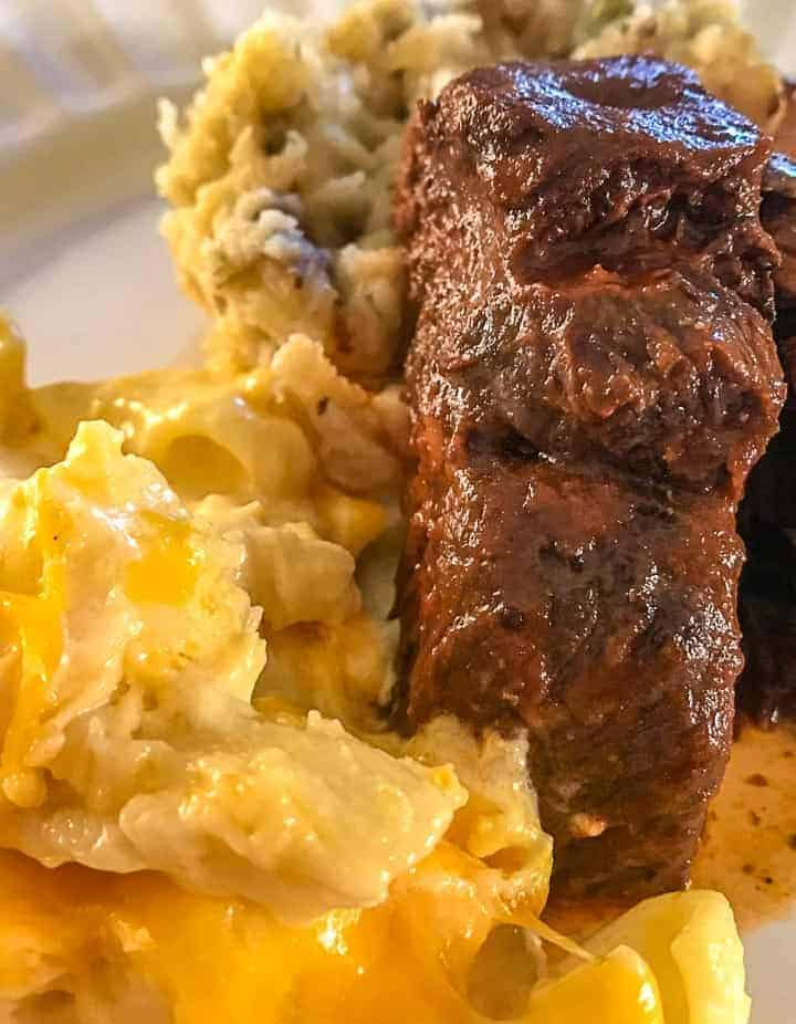 Country ribs and macaroni and cheese on white plate