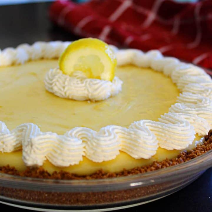 Lemon icebox pie garnished with scalloped whip cream edging