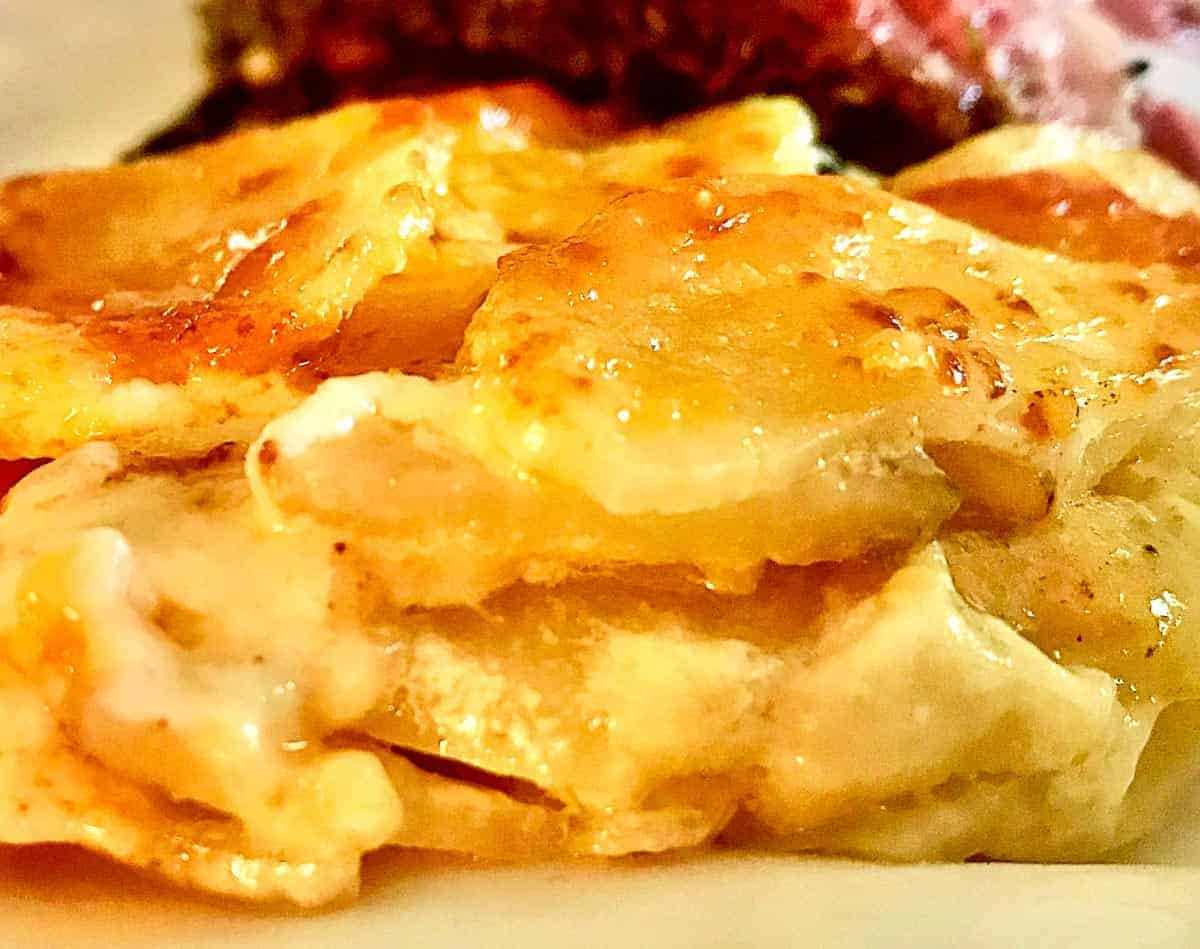 Close up side view of scalloped potatoes