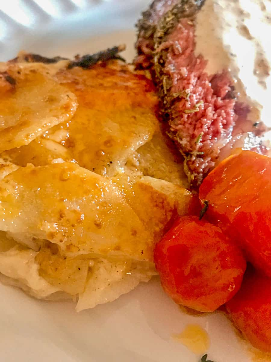 Potato Dauphinoise (Scalloped Potatoes) with a side of carrots and prime rib