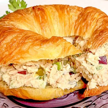Southern Tuna Salad on croissant on a purple plate