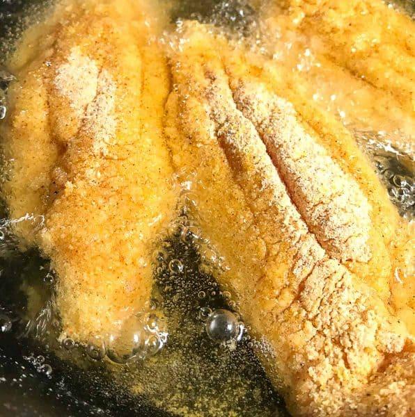 Three catfish filets in frying oil