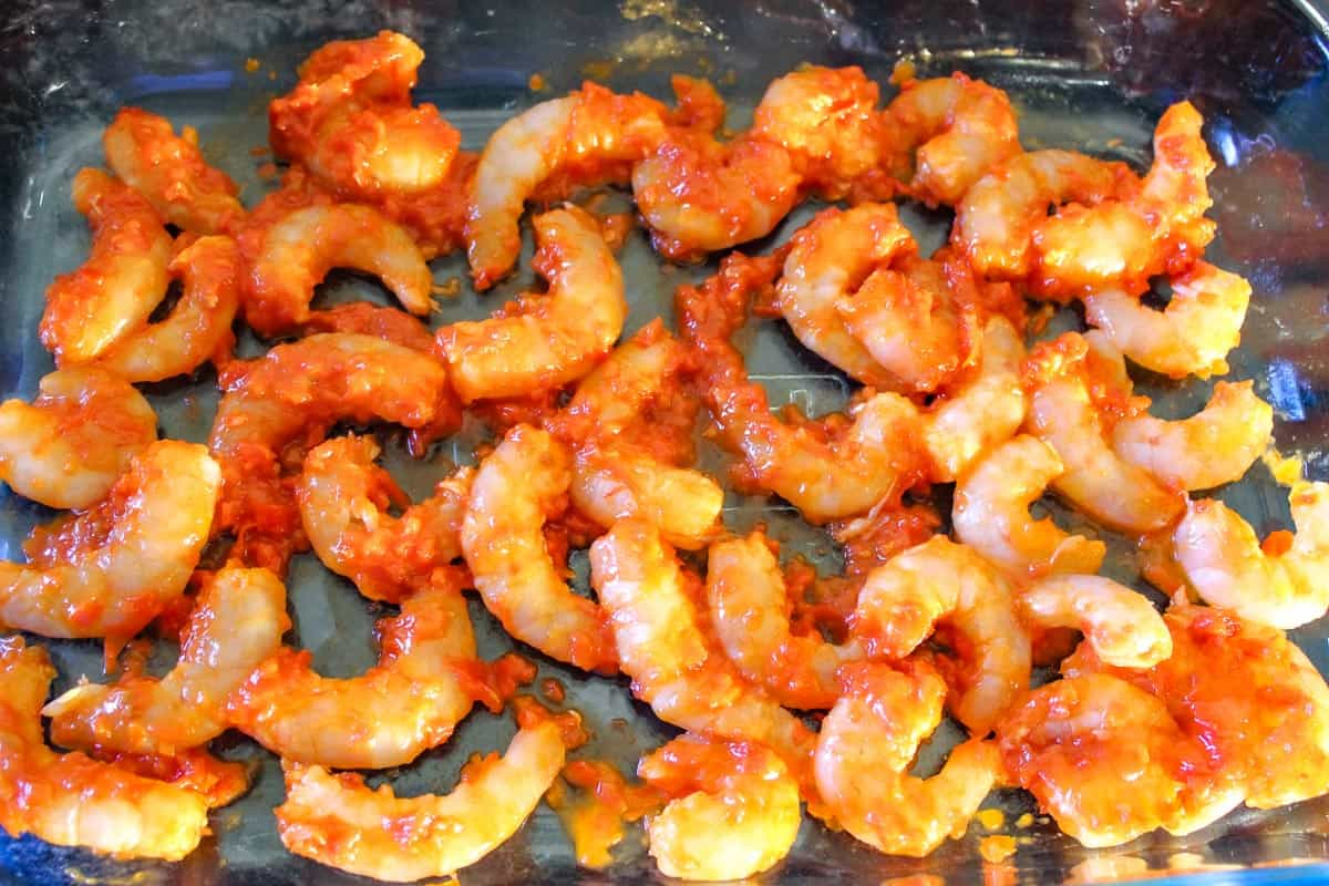 Shrimp coated with Harissa in baking dish