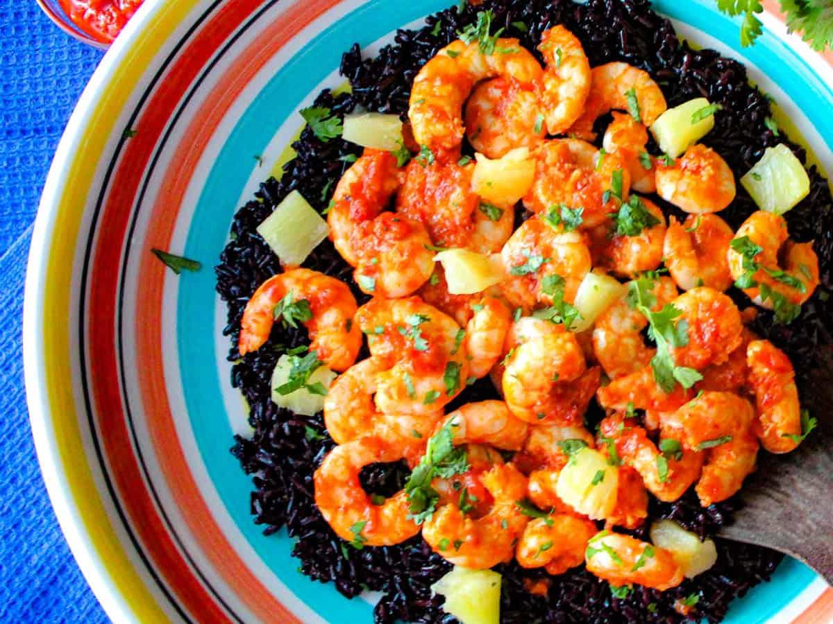Harissa shrimp and black rice in colorful bowl