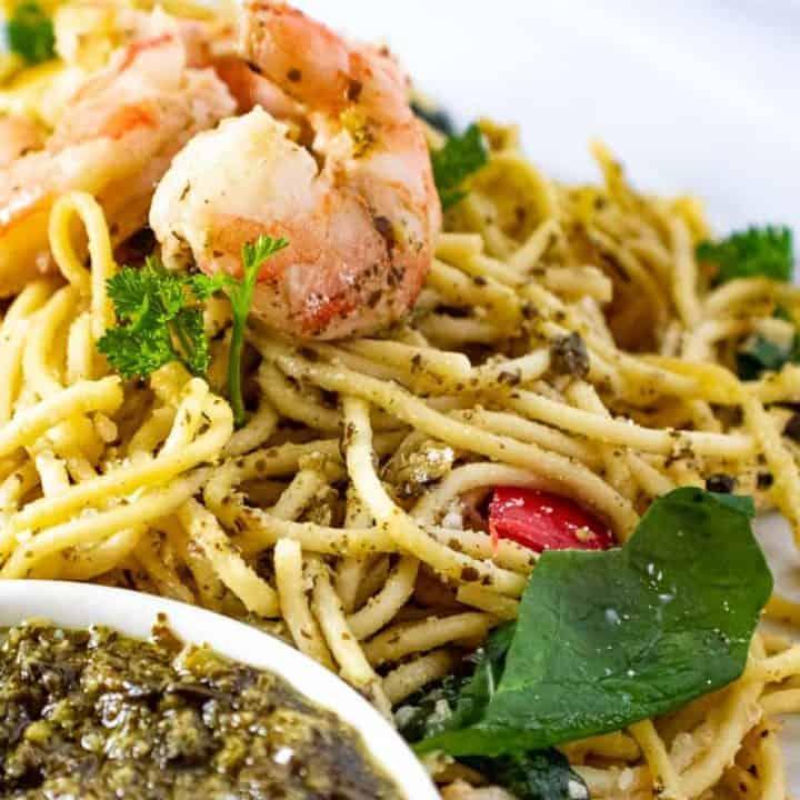 Close up of shrimp and pasta with pesto
