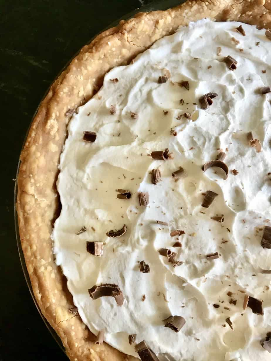 Old Fashioned Chocolate Pie topped with whipped cream and chocolate shavings