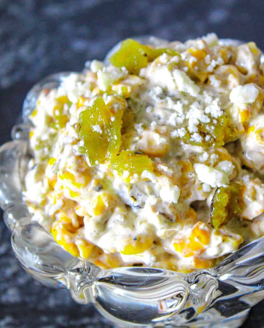Roasted corn and green chile dip in glass bowl
