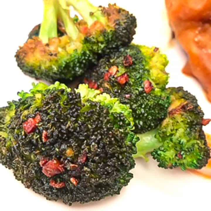Roasted broccoli on a white plate