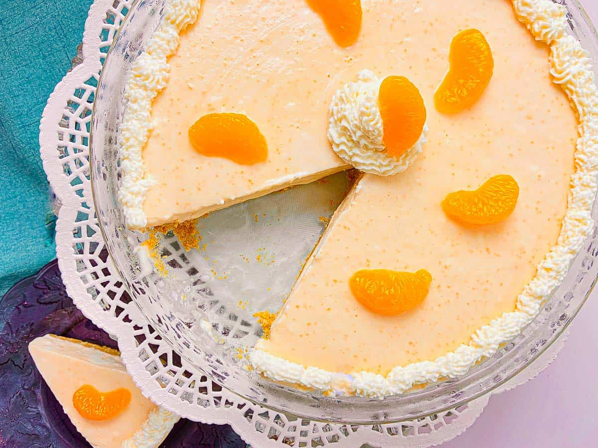 Orange Creamsicle Pie garnished with whipped cream edging and mandarin oranges