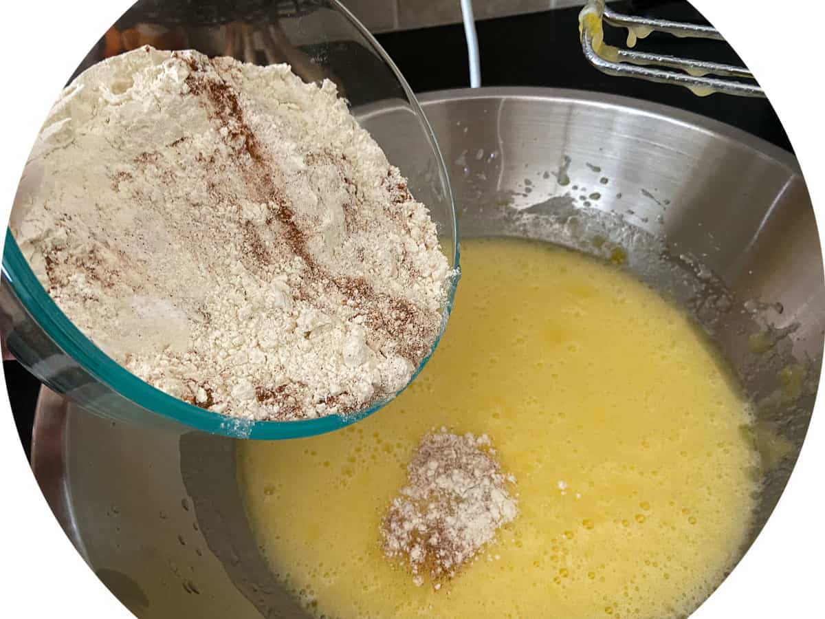 Dry ingredients being added to sugar mixture