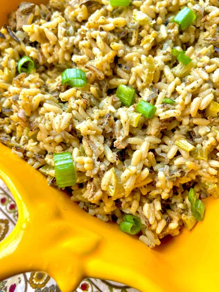 Wild Rice and Oyster Dressing in a yellow serving dish