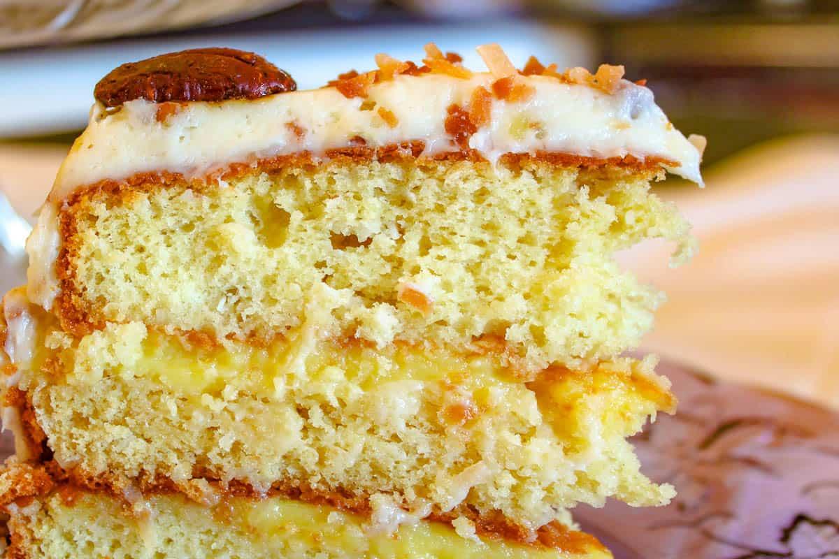Close up of a slice of Orange Italian Cream Cake