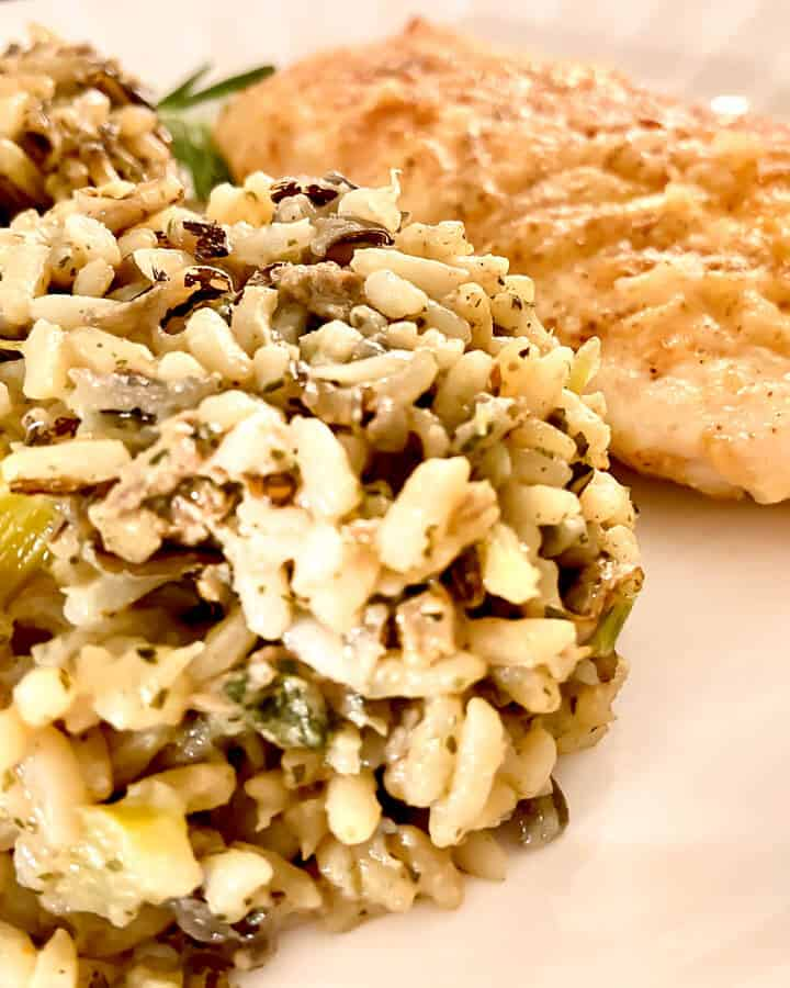 Wild Rice and oyster dressing on a white plate