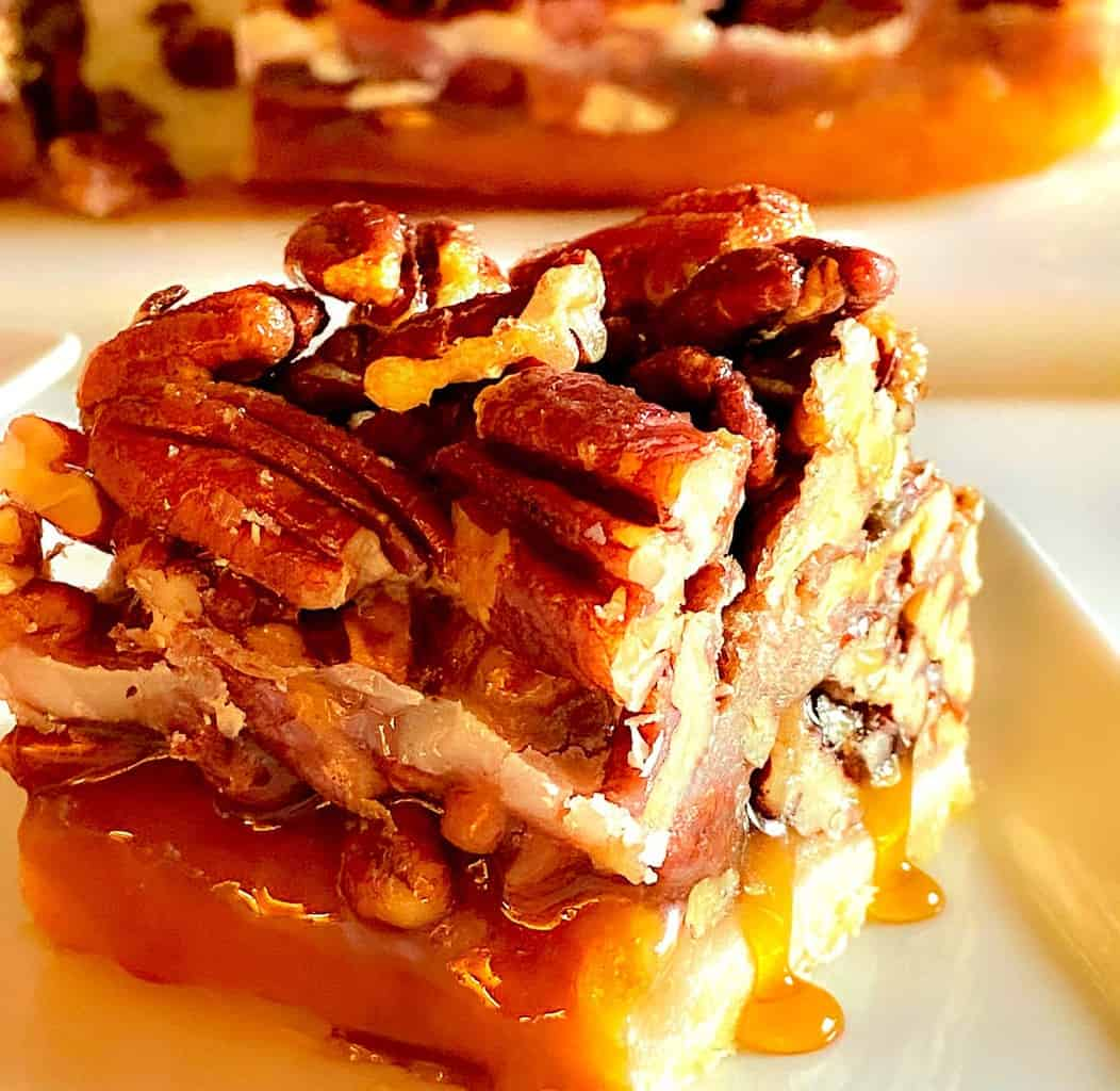 Square cut of Texas Pecan bar on a white plate