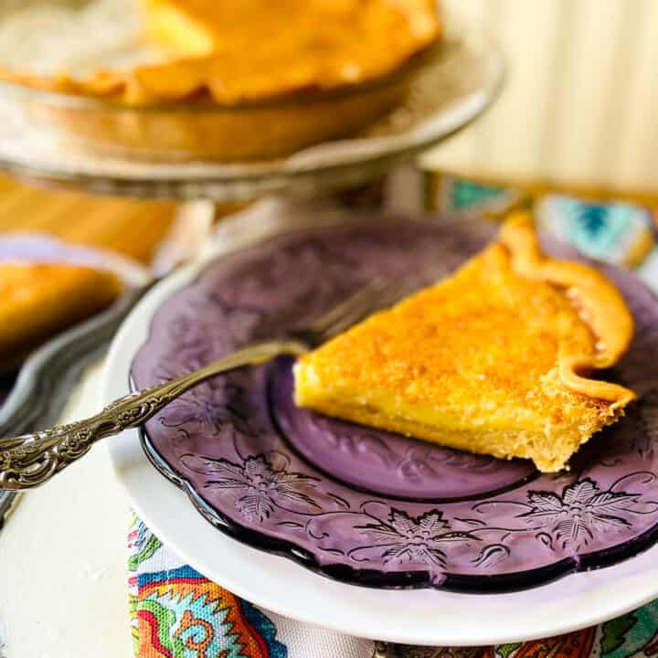 A slice of buttermilk pie on purple plate