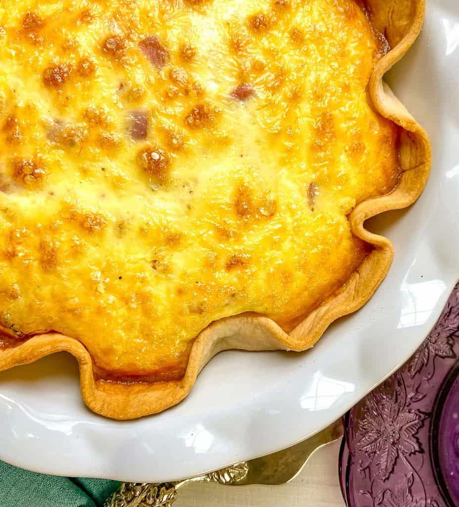 Quiche in a white scalloped pie plate