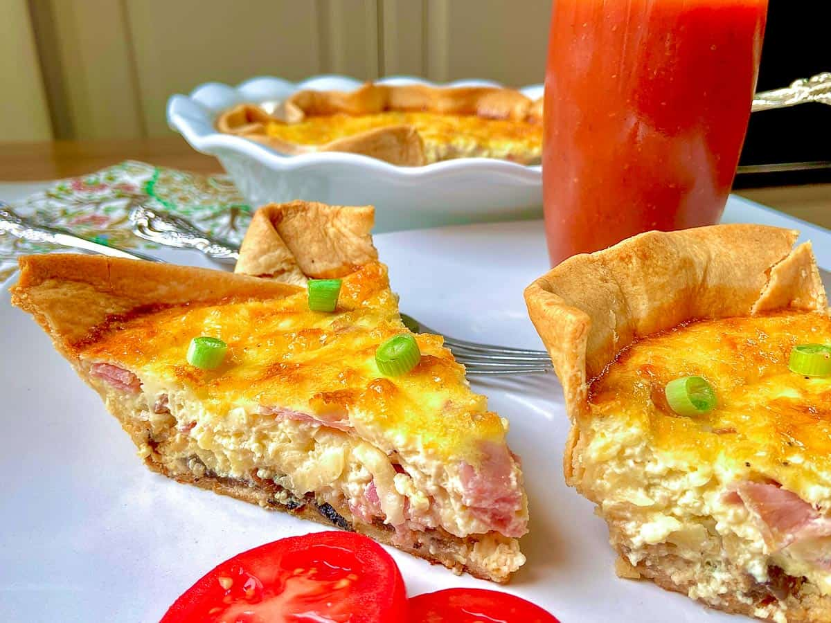 Two slices of quiche on white plate
