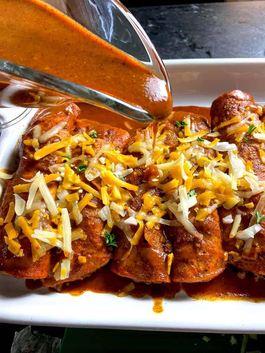 Red Enchilada sauce drizzled over enchiladas