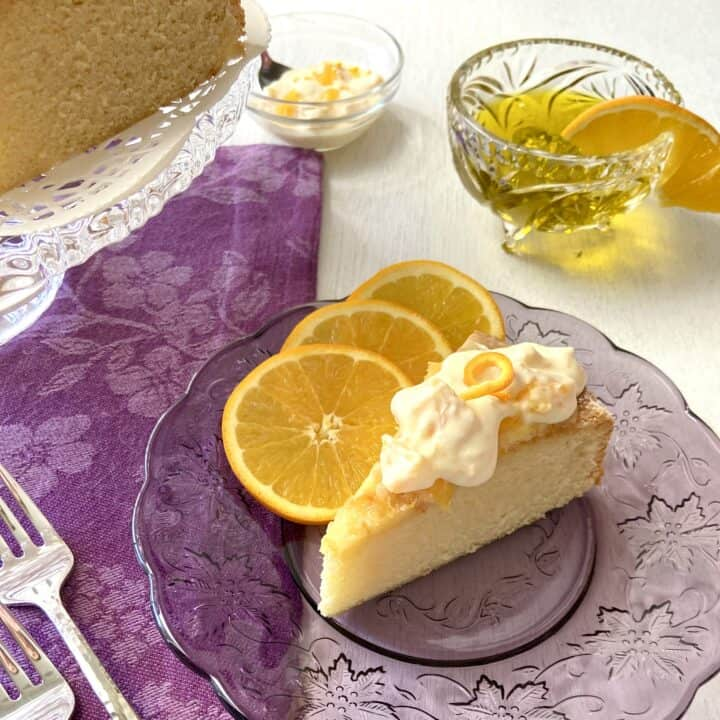 Slice of European Orange Olive Oil cake on purple plate