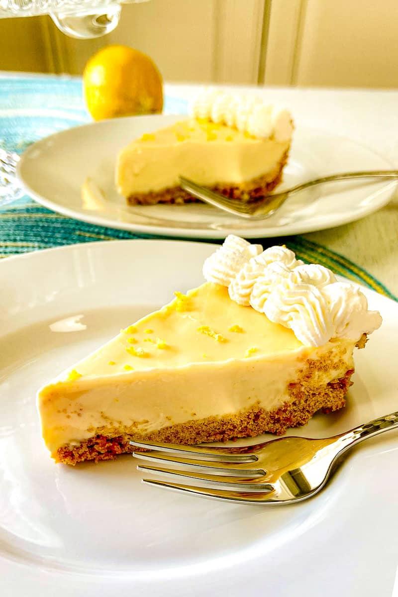 Slice of lemon icebox pie on white plate.