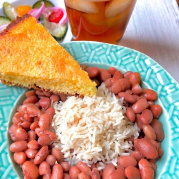 Pinto beans and rice with a slice of cornbread on the side.