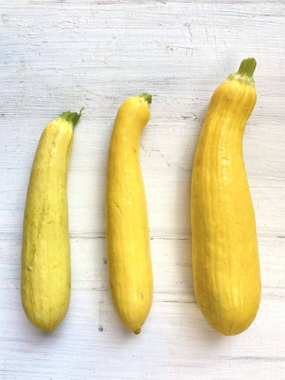 Three sizes of squash on a table.