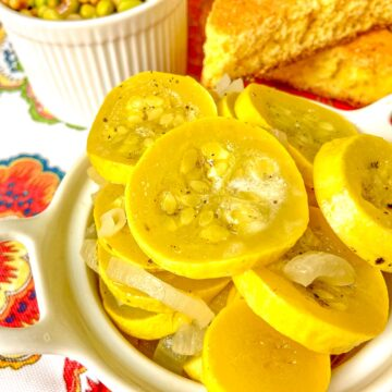 Sauteed yellow squash and onions in white bowl.