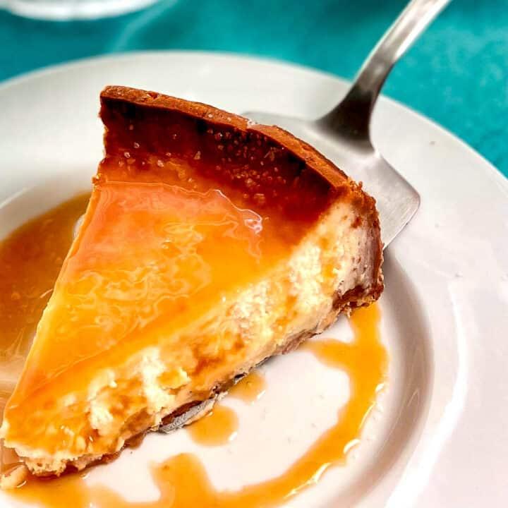 Slice of cheesecake on cake server.