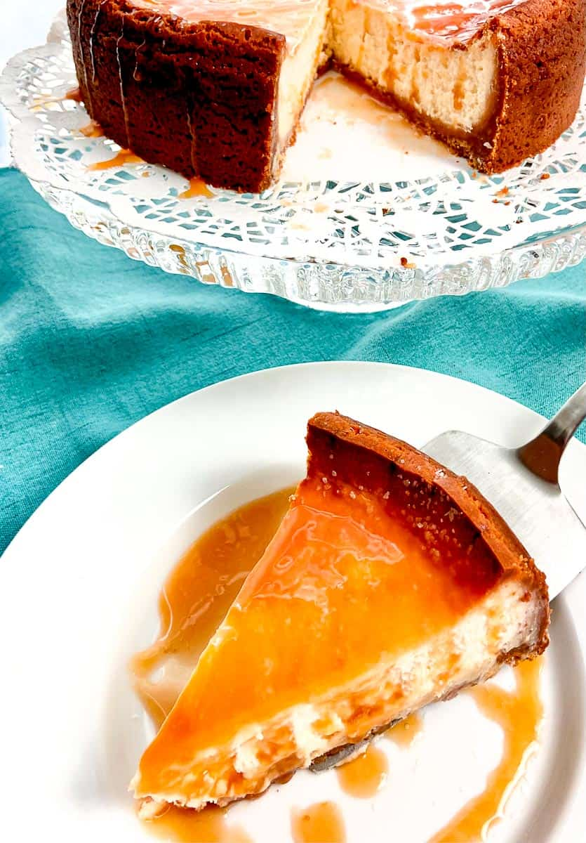 Salted caramel cheesecake on white plate.