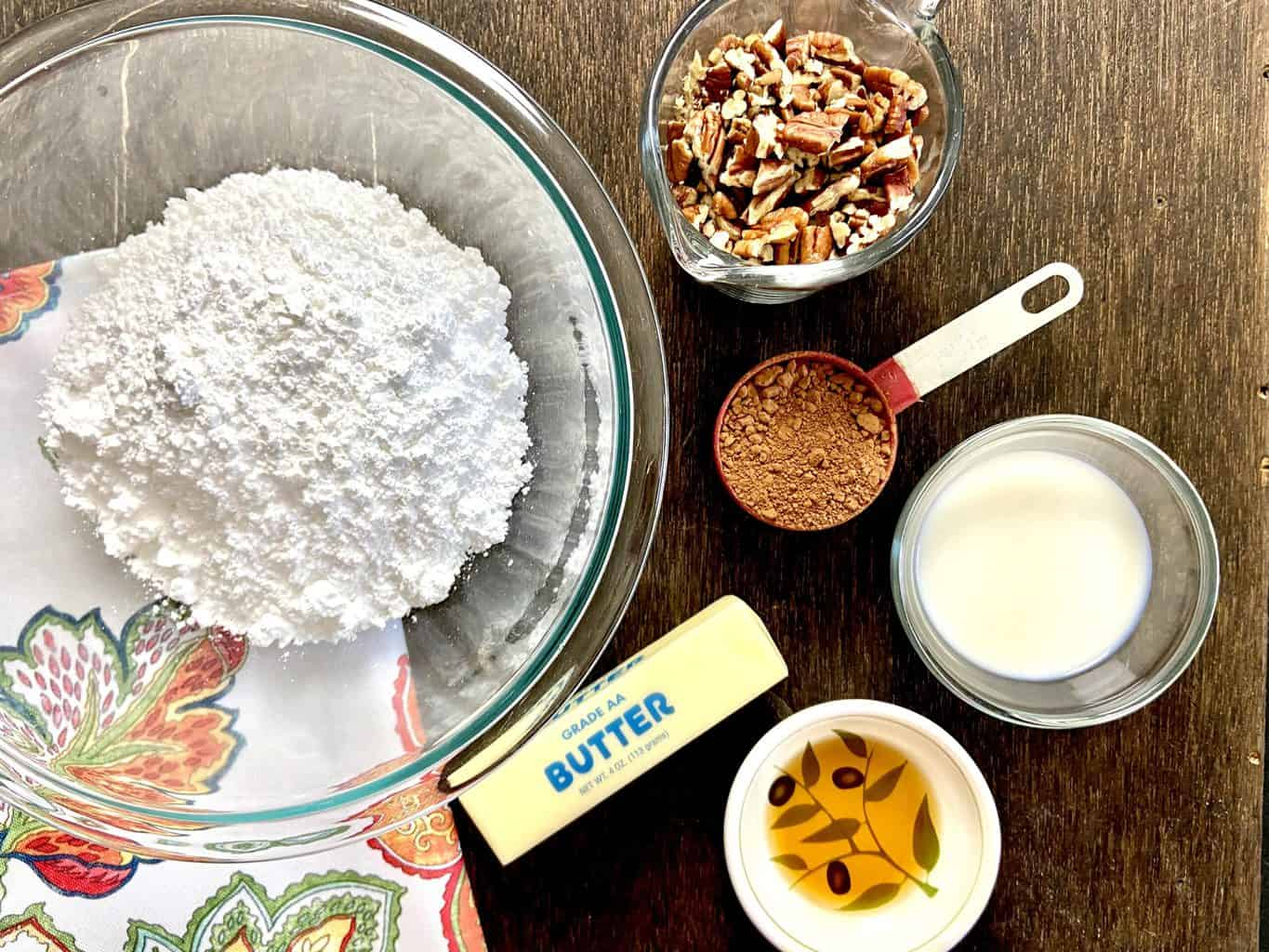 Chocolate pecan icing ingredients on counter.