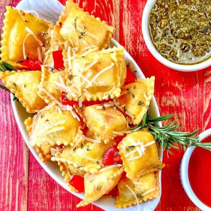 Pan fried ravioli on serving platter.