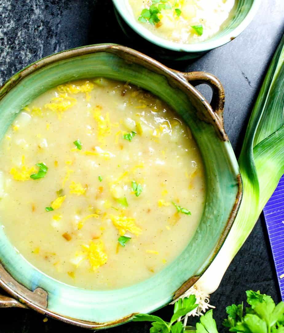 Vegan potato soup in green bowl.