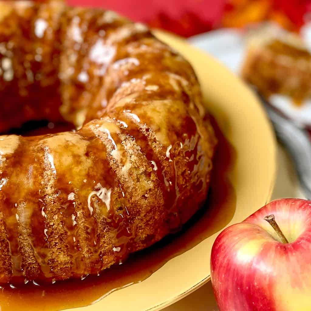 Apple cake on gold plate.