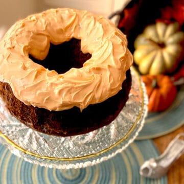 Cinderella Cake with orange icing on cake pedastal.