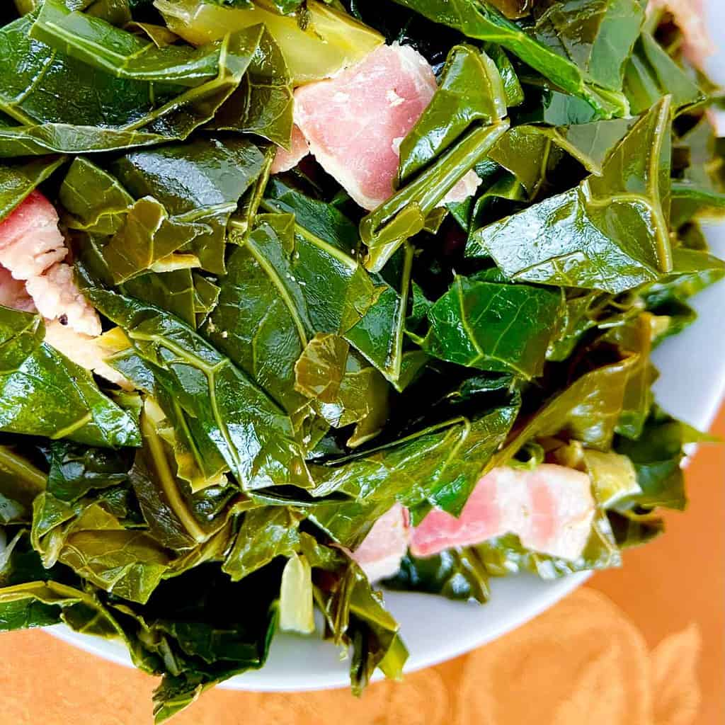 Seasoned greens in a white bowl.