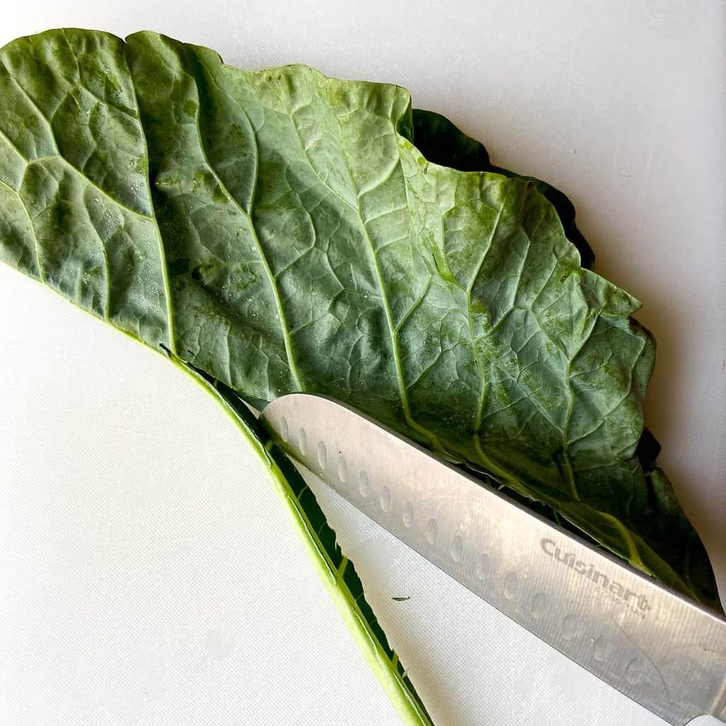 Sharp knife being run along the stem.