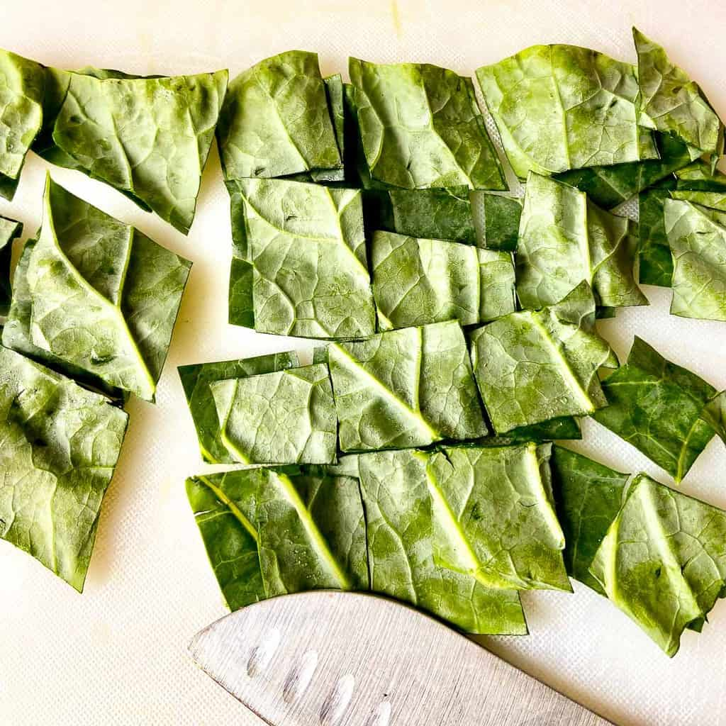 Stacked leaf greens cut into squares.